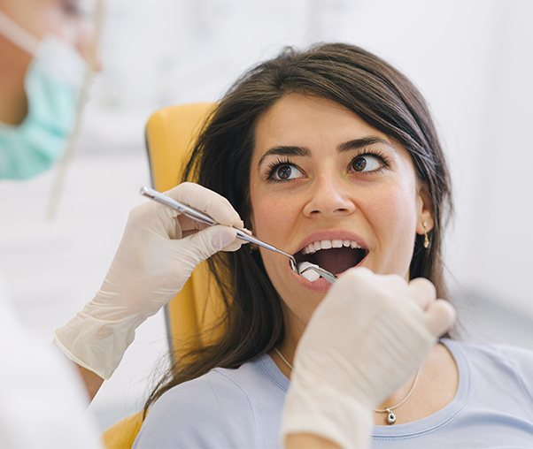 Dentist performing a wisdom tooth extraction